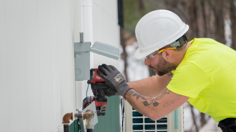 An electrical contractor works on a building for the city of Emily, Minn. that was built at a discount through Sourcewell contracts.