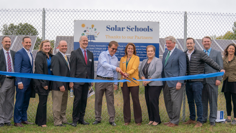 Image of the ribbon cutting for the Solar Schools project, which was funded in part by Sourcewell.