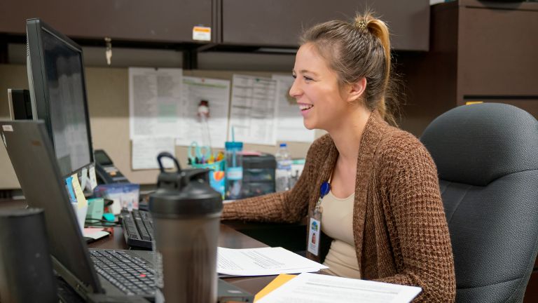 Social worker Sarah Harshman works at the computer in her office. Harshman was hired full-time by Wadena County after interning with the organization as a part of Sourcewell's internship program.