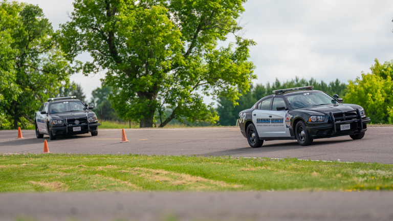 Image of several police cars on a driver training course.