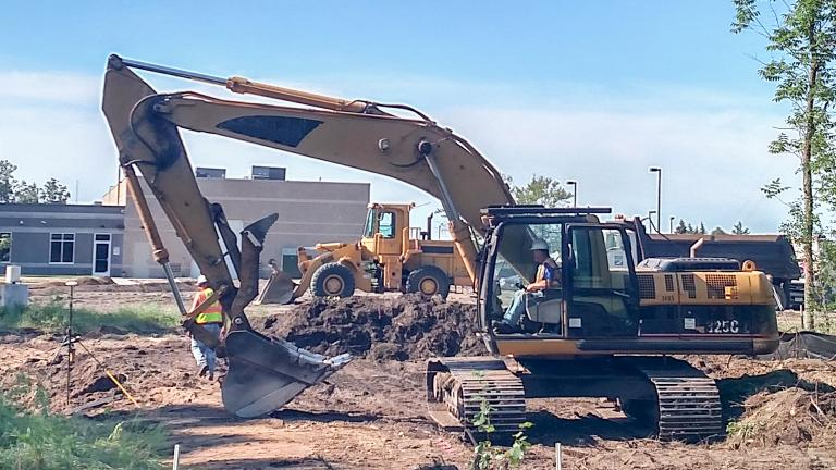 heavy equipment being used to prepare a construction site