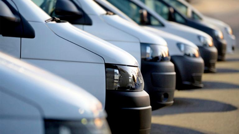 side image of a row of parked matching vehicles from a city fleet