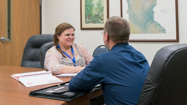 Nicole Rubbelke, a former intern turned full time employee, meets with her Supervisor at Wadena County Human Services during her Sourcewell-subsidized internship.