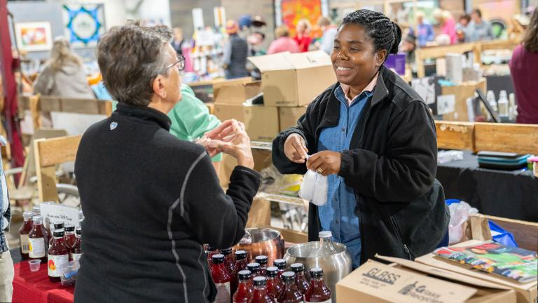 a local vendor and area resident discuss locally sourced products as a part of the Sprout Food Market, a nonprofit program supported by Sourcewell funding programs