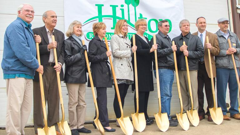 a group of community leaders with golden shovels at an official groundbreaking ceremony