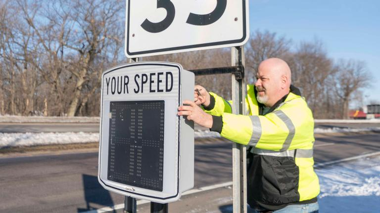A local city worker sets up a speed sign that was purchased through Sourcewell Innovation Funding and is now shared by government agencies within the five-county service area